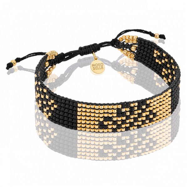 Black woven bracelet with gold-plated beads