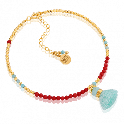 Bracelet of coral and magnesite stones with a mint green tassel